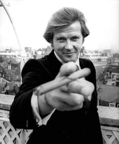 """not visually, just SPIRITUALLY """"my Bond is a lover and a giggler"""" -Roger Moore"""" Roger Moore, Hollywood Icons, Hollywood Stars, Humphrey Bogart, Photo Star, People Smoking, Tony Curtis, James Bond Movies, Cinema"""