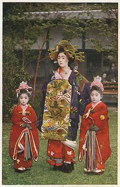 Oiran with kamuro, (By noel43).  Late 19th c hand-colored print)