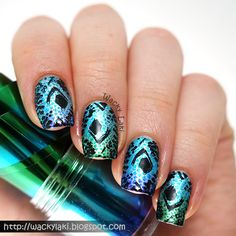 After transferring the foil onto my nails, I stamped over it using Essence Icy Princess (a silver) and Winstonia plate W101. I then stamped using Wet 'n Wild Black Creme and Pueen plate Pueen14...