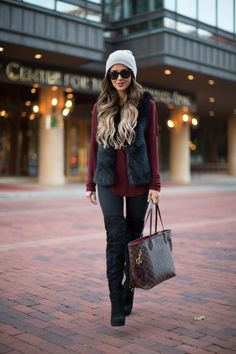 OCTOBER 22ND, 2015 BY MARIA Faux Fur & Boots - Topshop Faux Fur Vest // Banana Republic Wine-Colored Top // Topshop Black Jeans // Sam Edelman Over-The-Knee Boots // Nordstrom Beanie // Ray-Ban Sunglasses // Louis Vuitton Bag // Michael Kors Bag Charm
