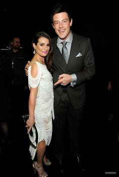 Cory Monteith. There is something interesting about this photo. He is so proud of her winning her award, but she doesn't even care. She has it hanging at her side and just poses for a picture with her boyfriend, like he is all that she cares for. I love it.