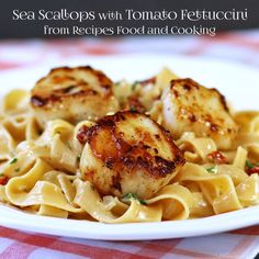 Sea Scallops with Tomato Fettuccine - sauteed sea scallops with fettuccine with heavy cream, sun dried tomatoes, parsley, garlic, onions and Parmesan cheese