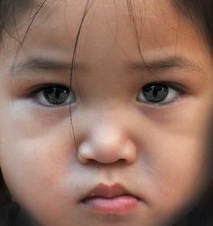 What a serious face on this little girl from Laos. I wonder what is going through her mind? -- eaf <3