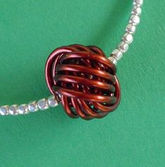 Make a Danish knot - note the chart at the bottom of the post.  Use large nails as mandrills.  #wire #jewelry #tutorial