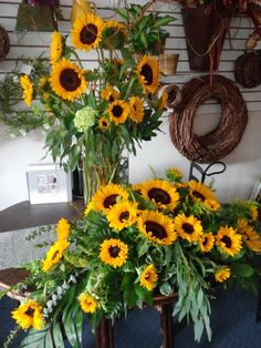 Sunflowers in casket spray and matching vase