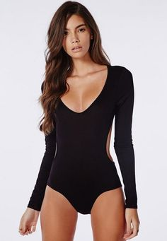 Channel seductive vibes with this backless bodysuit. In sleek black, this super soft bodysuit makes the perfect base and go-to party piece. Team with anything from high waisted jeans to a ribbed midi and heels.