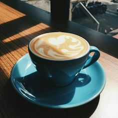 Aqua blue ceramic cup by Akrabi Coffee.