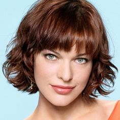 Milla Jovovich; love this color & it's the perfect amount of wave/ curl