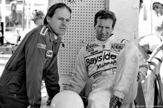 Two standout drivers in sports car racing during the 1970s and 1980s, Al Holbert (left) and Hurley Haywood wait for the start of practice in 1982.