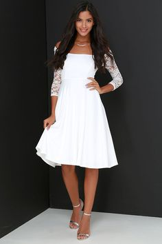 You'll be the epicenter of attention when you hit the town in the Central Square Ivory Lace Midi Dress! Sleek and stretchy knit falls elegantly into a wide bateau neckline finished with sheer, stretch lace off-the-shoulder half sleeves (with no-slip strips). A fitted bodice with princess seams continues to the fitted waist, then flares out into a chic, midi-length skirt. Hidden back zipper. Dress is lined; Sleeves are not. Self: 92% Polyester, 8% Spandex. Contrast: 90% Nylon, 10% Spandex....