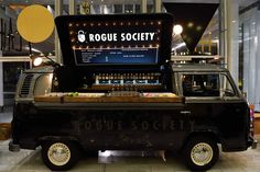 Rogue Society Gin | BOUDI industrial long arms lights