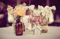 Love the rustic-looking mismatched arrangements.