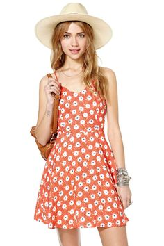 Get your frolic on in this seriously cute sun dress!  It has a deep v-neckline, spaghetti straps ...