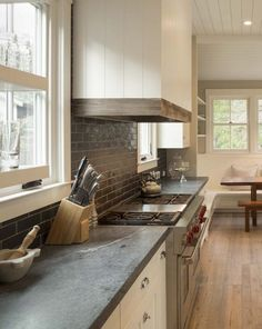 Tour this modern farmhouse, which speaks San Francisco style to a tee. Designed by Jennifer Tidwell from Postcard Properties and Heidi Richardson of Richardson Architects. Inside a Stylishly Simple Modern Farmhouse Tile Counters, Concrete Countertops, Kitchen Backsplash, Kitchen Countertops, Diy Kitchen, Kitchen Dining, Kitchen Decor, Backsplash Ideas, Kitchen Ideas