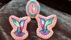 Hummingbird earrings and ring on smoked hide. #skydancerdesigns #beading #beadwork #accessories #earrings