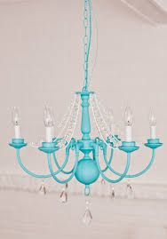 A vintage turquoise painted chandelier