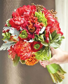 Bouquet of dahlias, ranunculuses, bells of Ireland, celosia, zinnias, brunia berries, variegated pittosporum, and dusty miller    $200, by Scarlet Petal, Chicago