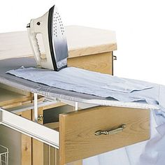 """199.99 Ironing Board in a Drawer--brilliant! Technical Details: Convenient and space saving Ingenious mechanism pops-up and unfolds into full ironing board Optional sleeve board available Durable metal construction Anti-heat reflective covering on all ironing surfaces. It requires a minimum cabinet size of 3-1/4"""" High by 14-1/4"""" Wide by 20"""" D. Full board measures 37-1/2"""" x 12"""". The Sleeve board measures 16-1/2"""" x 4"""". Replacement covers also available."""