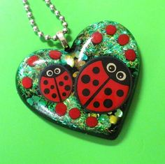 LadyBUG Party    resin heart pendant by HighStrungBead on Etsy, $22.00