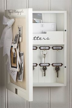 nice, simple key & mail storage - only thing I'd change is instead of a corkboard, I'd want a dry erase board. And a calender on the back of the door would complete it for me. And not white. Silver or gray.