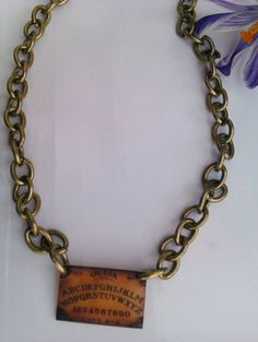 Very cool occult ouija board choker on a chunky bronze chain