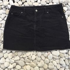 Black cord cut off mini skirt Very cute black corduroy cut off mini skirt. Waist 32 Hip 40 💥tag inside say 10💥 look at measurements! Super cute. Got it a long time ago. Sizing has changed a lot since then!!! Old Navy Skirts Mini