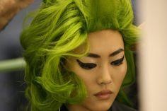 green hair, wing eyeliner