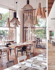 Mera-Brasserie-Poland | via Oh Joy - the mix of chairs: white, blk, grey plus wood & lighting...