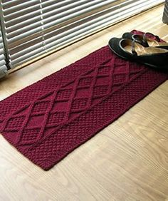 Free Knitting Pattern for One Skein Rug - Art Fiend's shoe rug features interesting cable and textures and is great for stashbusting. Other Ravelrers have added fringe or used this pattern for table runners and other projects.