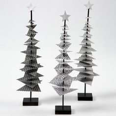 Christmas tree design paper stick with footThe Christmas trees are made from small triangular pieces of Vivi Gade design paper (the Paris design), attached to a black painted stick. Christmas Tree Design, Noel Christmas, Scandinavian Christmas, Modern Christmas, All Things Christmas, Christmas Crafts, Christmas Ornaments, Theme Noel, Painted Sticks
