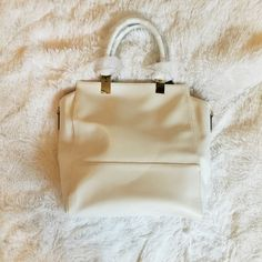 Brand New  JustFab Faux Leather Tote This bag is the definition of chic. Completely versatile with the addition of the shoulder strap. Plus, the gold detailing is everything. JustFab Bags
