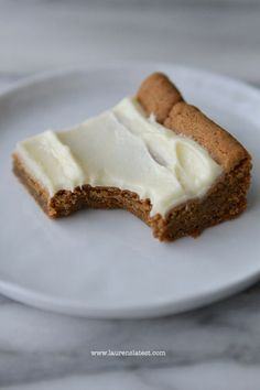 Soft and Chewy Gingerbread Bars with Cream Cheese Frosting.