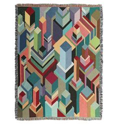 Geometric Afghans - Graphic artist brings colorful geometric art to a series of woven afghans...
