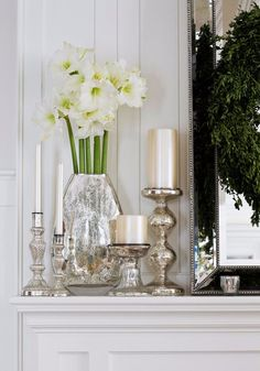 The pearlescent and silver hues of the mantel vignette are illumined by natural light for an extra dose of holiday shimmer. - Traditional Home ®/ Photo: Gordon Beall