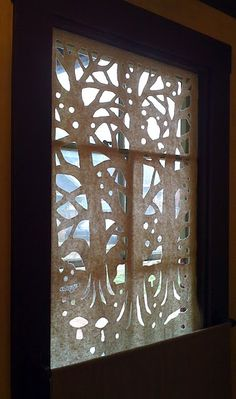 beautiful cut-out window coverings - this one is made from quilter's batting.