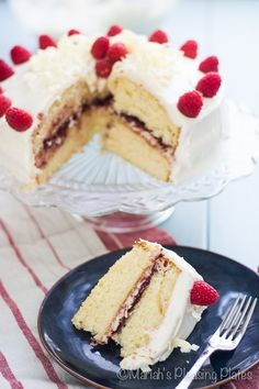 A decadent White Chocolate Raspberry Cake filled with sweet raspberry jam and topped with a smooth white chocolate cream cheese frosting. A beautiful way to celebrate any occasion.