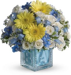 Baby's First Block by Teleflora - Blue Save 25% on this bouquet and many others with coupon code TFMDAYOK1B2 Offer expires 05/14/2012.
