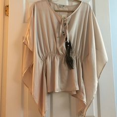 NWT Forever 21 blouse with Peacock string details This adorable top is a must! Color is a cream/pink. Never worn! Flowy and comfortable Forever 21 Tops Blouses