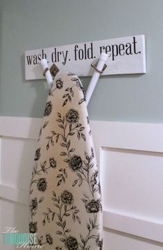 """How to Hang the Ironing Board Hanger Great option for having ironing boards that don't have """"T"""" shaped legs"""