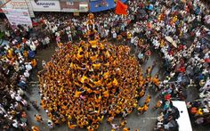 Devotees form a human pyramid during celebrations to mark Janmashtami festival in Mumbai