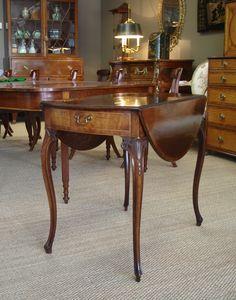 George III period mahogany Pembroke table, in the French Hepplewhite taste.
