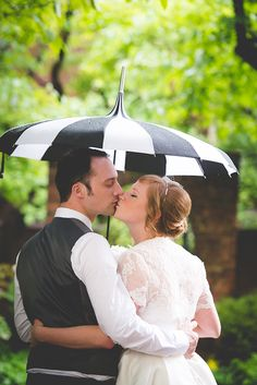 Retro wedding portraits with a black and white striped umbrella! | BG Productions Photography | Glamour & Grace