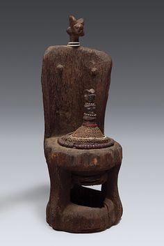 Africa | Medicine container inserted into a chair, from the Kwere people of Tanzania | Wood, gourd, glass beads, twine and organic materials