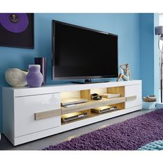 Wexford TV Stand In White And Oak With High Gloss Fronts And LED Lighting Features: •Wexford TV Stand In White And Oak With High Gloss Fronts And LED Lighting •Body: White Decor •Fro...