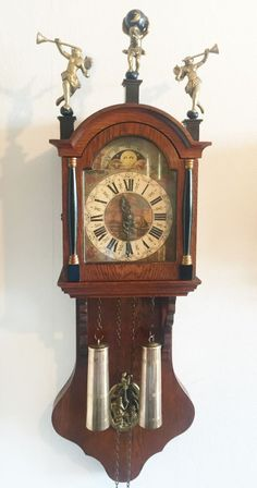 Low bids on eBay for this Large Vintage Warmink Dutch 8 Day Oak Friese Chain Driven Wall Clock, Moon Phase