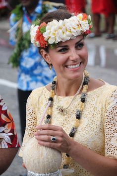 Catherine, the Duchess of Cambridge, wearing traditional headwear, drinks a coconut from a tree planted by Queen Elizabeth II during her 1982 tour, following Kate's arrival with husband Prince William in Funafuti in Tuvalu on September 18, 2012. Nearly half the population of 10,500 turned out to greet the future king and his wife