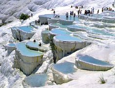 Pamukkale (Turkish) is 'cotton castle' and it likes the white castle. This beautiful spot is formed because of calcite in the water which have high concentration and become one of the most visited places in Turkey.