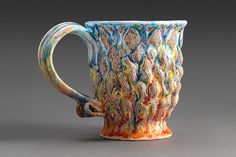 Handmade ceramic mug Song of Ice and Fire in red orange by Landby, $50.00