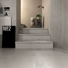 Stile industrial interpretato da #abkemozioni. #Floor: collezione #UNIKA di ABK, Grey Antique 60x120cm in #gres #porcellanato.  #ceramica #ceramics #tile #stairs