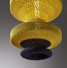 Omi pendant Lights are crochetpendant lamps by Dalston designerNaomi Paul, made of mercerised cotton and surplus silk from the fashion industry.
